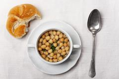 fresh broth with soup pearls - stock photo