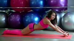 Beautiful girl has a gym in the fitness room Stock Footage