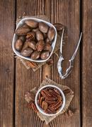 Some Pecan Nuts (selective focus) - stock photo