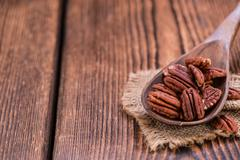 Heap of Pecan Nuts (selective focus) - stock photo