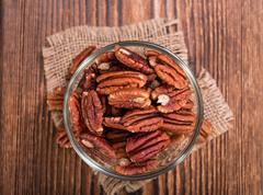 Heap of Pecan Nuts (selective focus) - stock photo