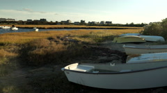 Camera Pans Right To Left, Over A Boats On Marshland, And Beautiful Harbor Stock Footage