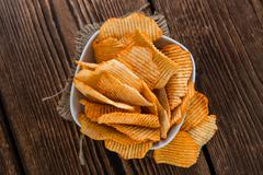 Potato Chips (rippled, selective focus) - stock photo