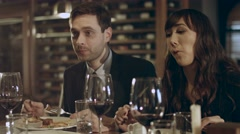 Family couple dines with friends - stock footage