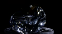 Single perfect diamond on a support on a black background Stock Footage