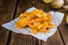 Heap of Chilli Potato Chips (selective focus) - stock photo