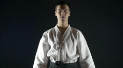 Karate with a black belt makes a bow, slow motion Stock Footage