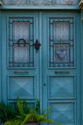 Stock Photo of Isolated classic style cyan wooden door house entrance