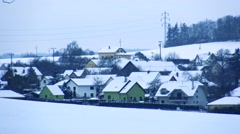 Snowy houses in small village Stock Footage