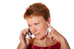 The woman talks cellular telephone Stock Photos