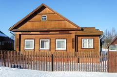 Old brown wooden house in winter time Stock Photos