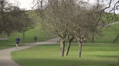 Lone runner in the park Stock Footage