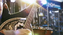 Young man playing on turkish saz guitar, 4k Stock Footage