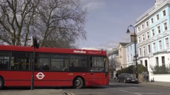 London street, red bus turn Stock Footage