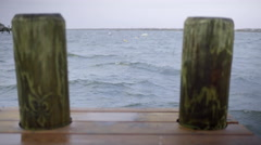 View From End Of A Dock Looking Out At Stormy Sea Stock Footage