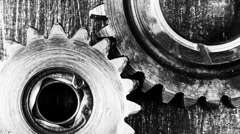 Timelapse of gears rotation on a metal background - stock footage