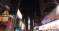 New York City street buildings driving moving tracking dolly Times Square night Stock Footage