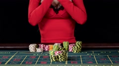 Woman wins roulette and takes away piles of chips at the casino. Black Stock Footage