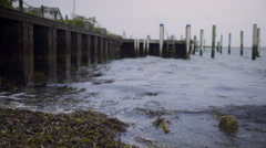 Waves Lap Against Harbor Dock On Nantucket Island, Massachusetts Stock Footage