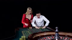 Couple playing roulette is eager to win. Black Stock Footage