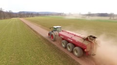 Tractor Hauling Down Lane #2 - stock footage