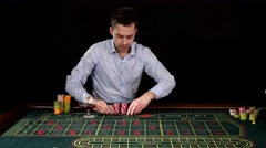 Excitable guy playing poker. Black Stock Footage