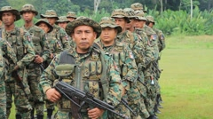 Soldiers with Weapons and Camouflage Stand in Formation - stock footage
