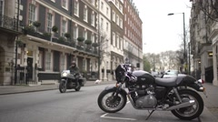 Motorcycle parked in the street Stock Footage