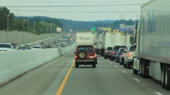 Driving on a busy interstate highway Stock Footage