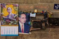 King of Thailand calendar in workshop - stock photo