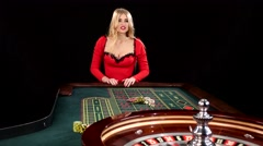 Woman stakes piles of chips playing roulette at the casino. Black Stock Footage