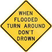 Road sign used in the US state of Texas - When flooded turn around - stock illustration