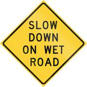 Road sign used in the US state of Texas - Slow down on wet road - stock illustration