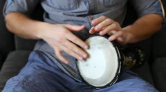 Playing Bongo drum close up HD stock footage. Hand tapping a Bongo drum in close Stock Footage