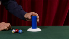 Magician Performs the Red Ball Magic Trick Stock Footage