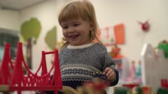 Toy road and bridge in the nursery children's room, the child plays Stock Footage