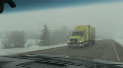 4k Driving Snow Winter Highway Traffic Hand Held Through Truck Windshield Stock Footage