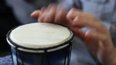 Playing Bongo drum close up HD stock footage. Hand tapping a Bongo drum in close - stock footage