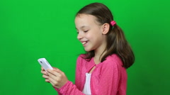 Technology and internet concept - little student girl with smartphone Stock Footage