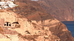 Ruins of old cave houses in the Santorini volcanic cliff. Stock Footage