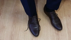 Man tying patent leather shoes formal and festive dressing - stock footage