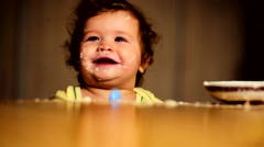 Home video about a happy child at the table Stock Footage