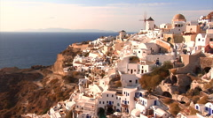 Santorini Island, Greece. Old windmill, cave houses, villas, and hotels in Oia. Stock Footage