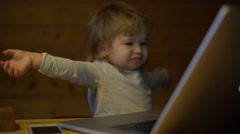4K cute little boy with phone and computer angry with technology problems Stock Footage