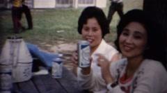 1961: Asian women canned beer drinking caucasian boyfriend. Stock Footage