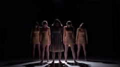 Five beautiful girls go on dancing modern contemporary dance, on black, shadow - stock footage