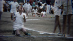 Stock Video Footage of 1961: Kid contest race track eating hotdog wacky competition event.