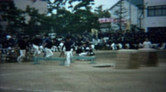 1961: Asian schoolboy obstacle course competition jump race. Stock Footage