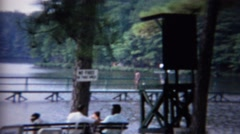 1961: Beach vacation spot picnic tables relaxing recreation area. Stock Footage
