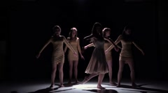 Graceful contemporary dance of five dancers in white clothes on black, shadow - stock footage